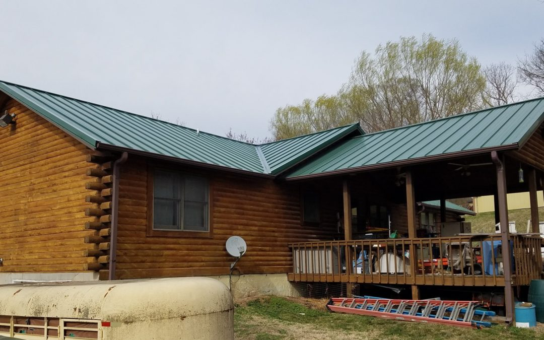 Green Standing Seam Steel Roof on a Log Cabin in Independence.